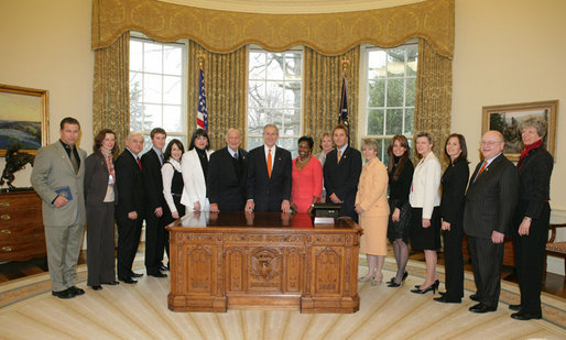 President George W. Bush poses with members of President's Council on Service and Civic Participation, Tuesday, Feb. 14, 2006 in the Oval Office of the White House. The council, created by the USA Freedom Corps in 2003, promotes volunteerism and recognizes Americans who serve our communities and the world. White House photo by Paul Morse