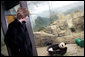 Mrs. Laura Bush watches baby Giant Panda, Tai Shan, play Tuesday, Feb. 14, 2006, at the Smithsonian National Zoological Park in Washington, DC. The Giant Panda is 7 months old and weighs over 33lbs. White House photo by Shealah Craighead