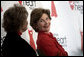 Laura Bush sits with Lois Ingland, a heart disease survivor, during an event at the Carolinas Medical Center Wednesday, Feb. 15, 2006, in Charlotte, NC. The four key risk factors of women with heart disease are smoking, obesity, high blood pressure, and high cholesterol. White House photo by Shealah Craighead