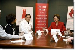 Laura Bush participates in a roundtable with Delphia Daniel, heart disease survivor, and Dr. Paul Colavita, Cardiologist, Sanger Clinic, at Carolinas Medical Center Wednesday, Feb. 15, 2006, in Charlotte, NC, to promote heart disease awareness, education and prevention. Heart disease is the leading cause of death of women in the US. White House photo by Shealah Craighead