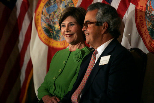 Laura Bush sits with Carlos del la Cruz, Event Host, during a Junior Ranger event Wednesday, Feb. 15, 2006, in Coral Gables, FL. The Junior Ranger programs introduces young people to America's national parks and historic sites, and is operating in 286 of the 388 National Parks across the country. White House photo by Shealah Craighead