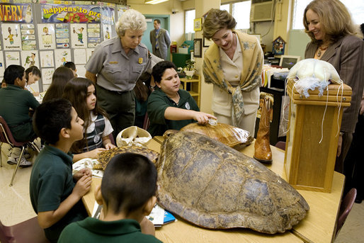 Laura Bush, listens to a student talk about Sea Turtles, Thursday, Feb. 16, 2006, as Fran Mainella, Director of the National Park Service, and Stella Summers, Teacher of the Gifted Science class, look on during a visit to Banyan Elementary School in Miami, FL, to support education about parks and the environment. White House photo by Shealah Craighead