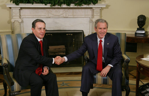President George W. Bush welcomes President Alvaro Uribe of Colombia to the Oval Office, Thursday, Feb. 16, 2006. White House photo by Paul Morse
