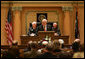 "Vice President Cheney recounts his early days in politics during an address to a joint session of the Wyoming State Legislature in Cheyenne, Friday, February 17, 2006. ""I would not be where I am today were it not for the friendship and the confidence of people all across this state,"" the Vice President said. ""It's always good to be home. And this morning, as an officeholder -- and, more than that, as a citizen of Wyoming -- I count it a high honor to be in such distinguished company."" White House photo by David Bohrer"