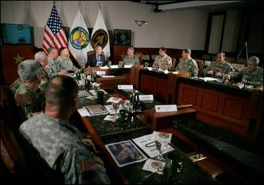 President George W. Bush joins CENTCOM and SOCOM Commanders for a briefing at the United States Central Command Headquarters in Tampa, Florida, Friday, Feb. 17, 2006. White House photo by Eric Draper
