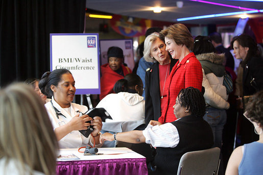 "Mrs. Laura Bush is joined by Mrs. Irene Pollin, left, Friday, Feb. 17, 2006, while attending the National Woman's Heart Day Health Fair at the MCI Center in Washington. Mrs. Pollin is the founder and president of Sister to Sister, a national grassroots nonprofit organization offering free heart disease screenings and ""heart-healthy"" information and support to women to prevent heart disease. White House photo by Shealah Craighead"