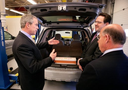 President George W. Bush views a hybrid vehicle powered by Lithium-ion batteries during a tour by Johnson Controls' CEO John Barth, far right, and employee Mike Andrew at the Johnson Controls' Battery Technology Center in Glendale, Wisconsin, Monday, Feb. 20, 2006. White House photo by Eric Draper