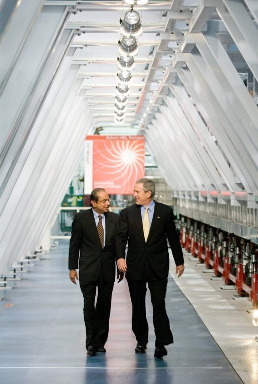 President George W. Bush and Dr. Subhendu Guha, President of United Solar Ovonic LLC, tour the company's solar cell production area in Auburn Hills, Michigan, Monday, Feb. 20, 2006. White House photo by Eric Draper