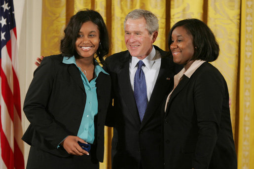 "President George W. Bush congratulates Carrietha ""Katie"" Ball and her sister, Karl'Nequa Ball of Jackson, Miss., after awarding them the President's Volunteer Service Awards during a White House celebration of African American History Month. White House photo by Paul Morse"