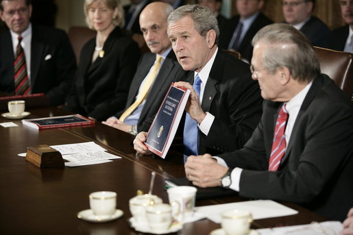 President George W. Bush holds a copy of the newly released report, The Federal Response to Hurricane Katrina: Lessons Learned, while talking to reporters at a Cabinet meeting Thursday, Feb. 23, 2006 at the White House. The report reviews the federal response to Katrina and makes recommendations about how to better respond in the future. White House photo by Eric Draper
