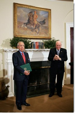 "Vice President Dick Cheney applauds Lieutenant Bernard W. Bail, recipient of the Distinguished Service Cross, in the Roosevelt Room at the White House, Friday, February 24, 2006. The Vice President awarded the Distinguished Service Cross to Lt. Bail for his extraordinary acts of heroism during World War II and commended Lt. Bail for being a ""brave citizen who elevated service to country above self interest.""  White House photo by David Bohrer"
