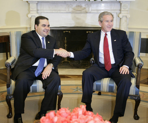 President George W. Bush welcomes President Antonio Saca of El Salvador to the Oval Office, Friday, Feb. 24, 2006 at the White House. White House photo by Eric Draper