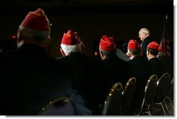 Members of the American Legion listen to Vice President Dick Cheney as he delivers remarks to the American Legion Washington Conference in Washington, Tuesday, February 28, 2006. During his address the Vice President commended those who have served in uniform and thanked veterans for defending the country and standing behind the military.  White House photo by David Bohrer