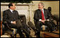 President George W. Bush smiles as he and Italian Prime Minister Silvio Berlusconi meet the media in the Oval Office Tuesday, Feb. 28, 2006. The President used the occasion to commend the Prime Minister for the stability he's brought to the Italian government and to applaud his country's recent success with the Olympic Games. White House photo by Kimberlee Hewitt