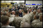 President George W. Bush meets with U.S. Marines headed to Iraq, during a stopover Tuesday evening, Feb. 28, 2006 at Shannon, Ireland's international airport terminal. President Bush visited with the Marines as part of his five-day visit to India and Pakistan. White House photo by Paul Morse
