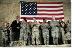 President George W. Bush meets and thanks a group of U.S. and Coalition troops, Wednesday, March 1, 2006, during a visit to Bagram Air Base in Afghanistan, where President Bush thanked the troops for their service in defense of freedom.  White House photo by Eric Draper