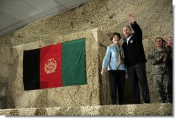 President George W. Bush and Laura Bush wave to an audience of U.S. and Coalition troops, Wednesday, March 1, 2006, upon their arrival to Bagram Air Base in Afghanistan. White House photo by Eric Draper