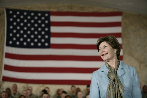Mrs.Laura Bush appears before an audience of U.S. and Coalition troops, Wednesday, March 1, 2006, during a visit to Bagram Air Base in Afghanistan, where President George W. Bush thanked the troops for their service in defense of freedom. White House photo by Eric Draper