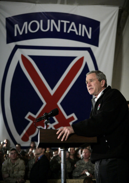 President George W. Bush addresses U.S. and Coalition troops Wednesday, March 1, 2006, during a stopover at Bagram Air Base in Afghanistan, prior to his visit to India and Pakistan. White House photo by Eric Draper