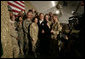 President George W. Bush poses for photos with U.S. and Coalition troops Wednesday, March 1, 2006, during a stopover at Bagram Air Base in Afghanistan, prior to his visit to India and Pakistan. White House photo by Eric Draper