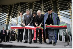 President George W. Bush and Afghanistan President Hamid Karzai, right, cut the ceremonial ribbon, Wednesday, March 1, 2006, to dedicate the new U.S. Embassy Building in Kabul, Afghanistan. President Bush is joined by Mrs. Laura Bush; U.S. Secretary of State Condoleezza Rice and U.S. Ambassador to Afghanistan Ronald E. Neumann.  White House photo by Eric Draper