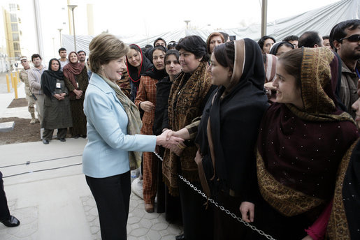 Mrs. Laura Bush greets a welcoming delegation of women, Wednesday, March 1, 2006, at the dedication of the new U.S. Embassy Building in Kabul, Afghanistan. White House photo by Eric Draper
