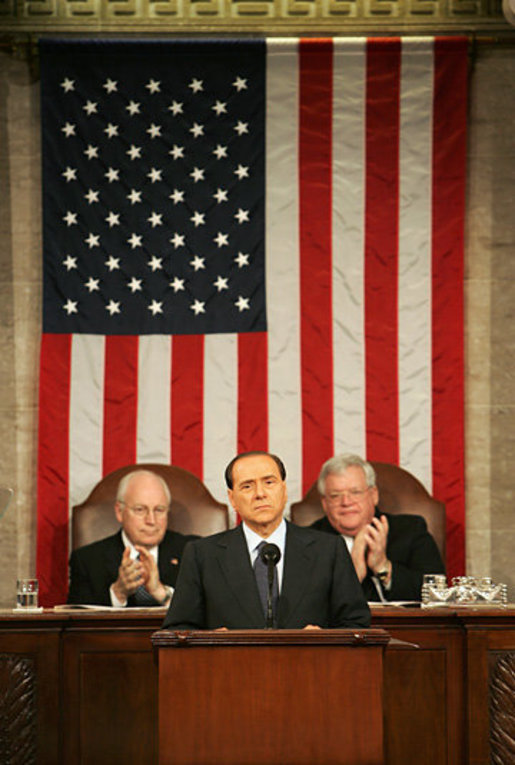 Vice President Dick Cheney and House Speaker J. Dennis Hastert applaud Italian Prime Minister Silvio Berlusconi during an address to a joint session of Congress, Wednesday, March 1, 2006. The Prime Minister's speech to the joint session was part of a three-day visit to Washington that included a visit to the White House, where he met with President George W. Bush and discussed Italy's continued allied relationship with the US in the global war on terror. White House photo by David Bohrer