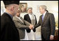 President George W. Bush meets members of President Hamid Karzai's government upon his arrival for a working lunch at the Presidential Palace in Kabul, Afghanistan Wednesday, March 1, 2006. White House photo by Eric Draper