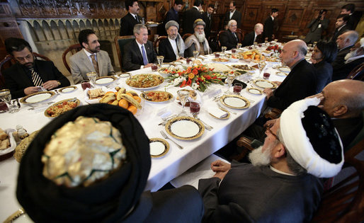 President George W. Bush and President Hamid Karzai of Afghanistan share a working lunch Wednesday, March 1, 2006, at the Presidential Palace in Kabul during a stop by President Bush en route to India. White House photo by Eric Draper
