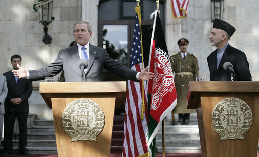 "President George W. Bush gestures as he speaks during a press availability Wednesday, March 1, 2006, with Afghanistan President Hamid Karzai at the Presidential Palace in Kabul. ""One of the messages I want to say to the people of Afghanistan,"" President Bush said, "" is it's our country's pleasure and honor to be involved with the future of this country."" White House photo by Eric Draper"