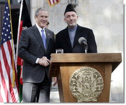 President George W. Bush and President Hamid Karzai of Afghanistan appear together Wednesday, March 1, 2006 at a joint news conference at the Presidential Palace in Kabul, Afganistan.  White House photo by Eric Draper