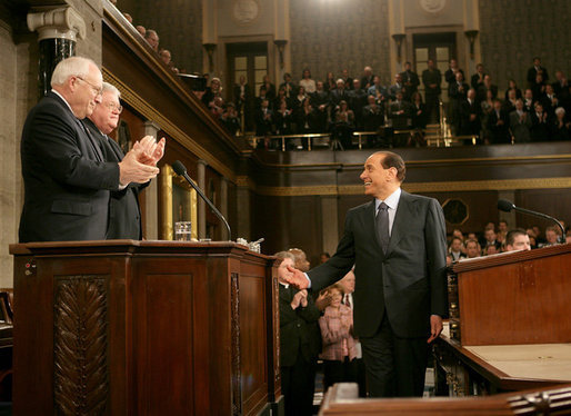 Italian Prime Minister Silvio Berlusconi smiles at Vice President Dick Cheney and House Speaker J. Dennis Hastert, as he gestures in response to a warm welcome given by members of a joint session of Congress, Wednesday, March 1, 2006. White House photo by David Bohrer