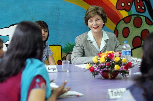 Mrs. Laura Bush listens to a question during an informal group discussion with teachers and students on her tour of Prayas, Thursday, March 2, 2006, in New Delhi, India. White House photo by Shealah Craighead
