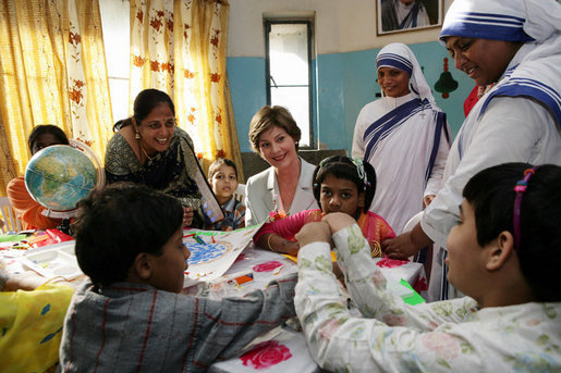 Mrs. Laura Bush meets with teachers and children, Thursday, March 2, 2006, during her visit to Mother Teresa's Jeevan Jyoti (Light of Life) Home for Disabled Children in New Delhi, India. White House photo by Shealah Craighead