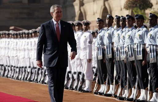 President George W. Bush reviews troops Thursday, March 2, 2006, during the arrival ceremony at Rashtrapati Bhavan, the presidential residence in New Delhi, welcoming he and Laura Bush to India. White House photo by Eric Draper