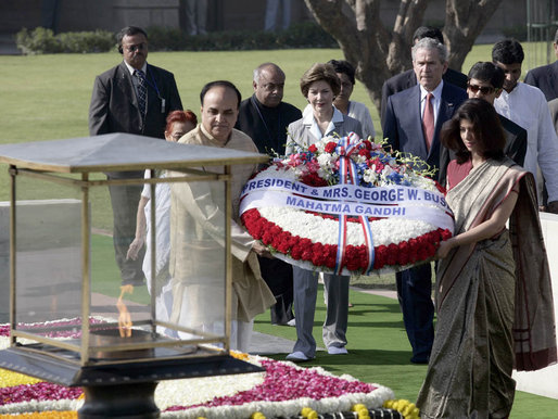 President George W. Bush and Laura Bush participate in a wreath-laying ceremony Thursday, March 2, 2006, in Rajghat, India, at the memorial for Mahatma Gandhi. White House photo by Eric Draper
