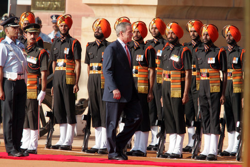 President George W. Bush participates in the troop review Thursday, March 2, 2006, during the arrival ceremony at Rashtrapati Bhavan in New Delhi. White House photo by Paul Morse