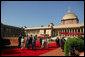 President George W. Bush and Laura Bush arrive at Rashtrapati Bhavan in New Delhi Thursday, March 2, 2006, and are escorted to welcome ceremonies by India's President A.P.J. Abdul Kalam and Prime Minister Manmohan Singh and his wife, Gusharan Kaur. White House photo by Paul Morse