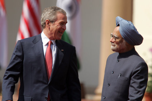 "President George W. Bush smiles as he stands with India's Prime Minister Manmohan Singh during a press availability in New Delhi Thursday, March 2, 2006. The President told those in attendance that India and America ""have built a strategic partnership based on common values,"" and thanked the Indian people and the Indian government ""for supporting the new democracy in the neighborhood."" White House photo by Paul Morse"