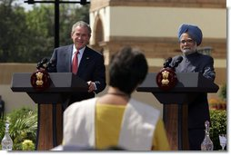 President George W. Bush smiles as he responds to a question Thursday, March 2, 2006, during a press availability with India's Prime Minister Manmohan Singh in the Mughal Garden at the Hyderabad House in New Delhi.  White House photo by Paul Morse