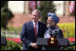 President George W. Bush and India's Prime Minister Manmohan Singh exchange handshakes Thursday, March 2, 2006, after their press availability at the Hyderabad House in New Delhi. White House photo by Paul Morse