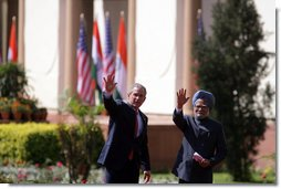 President George W. Bush and Prime Minister Manmohan Singh of India wave as they leave Mughal Garden at the Hyderabad House after a press availability in New Delhi Thursday, March 2, 2006.  White House photo by Paul Morse