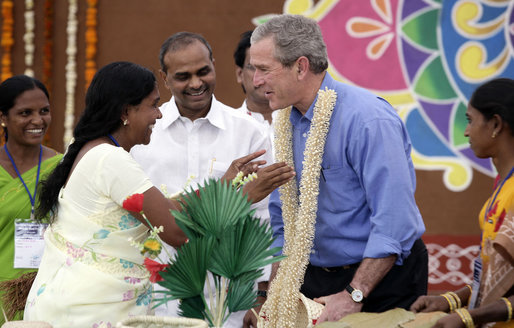 President George W. Bush is presented with a flowered neck garland upon his arrival Friday, March 3, 2006, to Acharya N.G. Ranga Agriculture University in Hyderabad, India. White House photo by Eric Draper