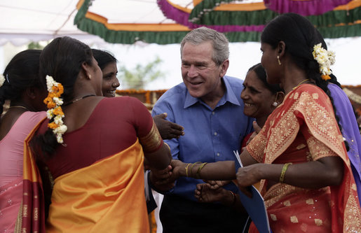 President George W. Bush is surrounded by fans as they pose for photos Friday, March 3, 2006, at the Acharya N.G. Ranga Agriculture University in Hyderabad, India. White House photo by Eric Draper