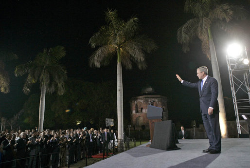President George W. Bush waves as he leaves the stage Friday, March 3, 2006, after delivering remarks at Purana Qila in New Delhi before departing India for Pakistan. White House photo by Eric Draper