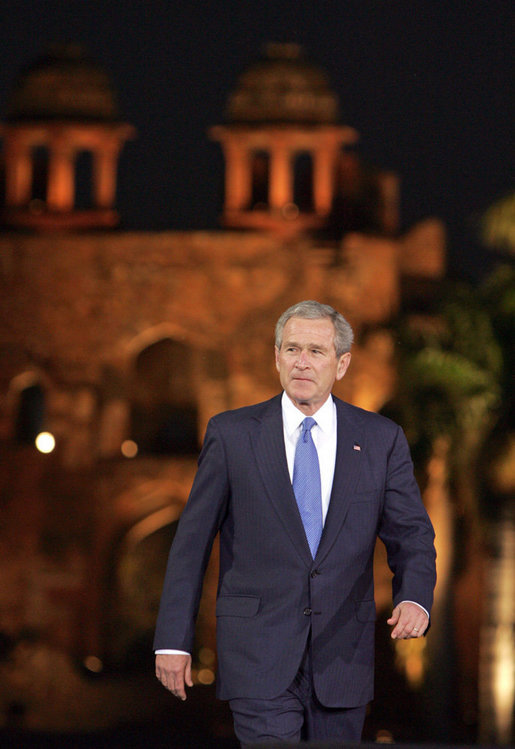 President George W. Bush acknowledges the audience as he arrives for remarks Friday, March 3, 2006, at the Purana Qila in New Delhi. White House photo by Paul Morse