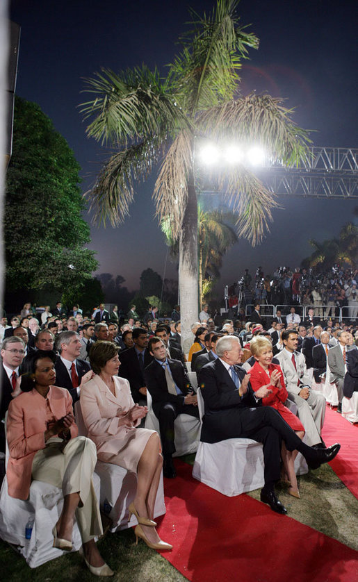 Laura Bush sits with Secretary of State Condoleezza Rice as they listen to President Bush's remarks Friday evening, March 3, 2006, in New Delhi. White House photo by Shealah Craighead
