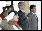 President George W. Bush and Pakistan President Pervez Musharraf stand together during President Bush's official welcome to Aiwan-e-Sadr in Islamabad, Pakistan, Saturday, March 4, 2006. White House photo by Eric Draper
