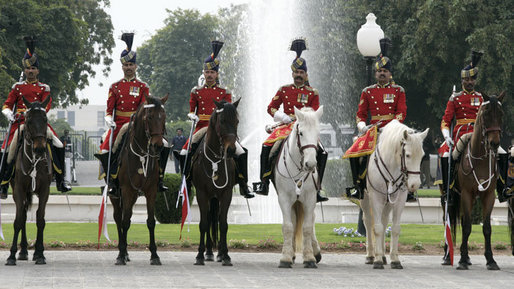 A Pakistan cavalry honor guard welcomes President George W. Bush to Aiwan-e-Sadr in Islamabad, Pakistan, Saturday, March 4, 2006. White House photo by Eric Draper