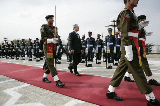 President George W. Bush is escorted by an honor guard as he reviews Pakistan troops at his official welcome to Aiwan-e-Sadr in Islamabad, Pakistan, Saturday, March 4, 2006. White House photo by Eric Draper